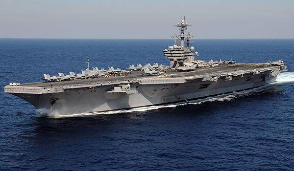 """THE """"AVENGER"""": Commissioned in 2009 and first deployed in 2011, the George H.W. Bush is the last of the Nimitz-class super carriers. As the flagship of the Navy's Carrier Strike Group 2, she commands a flotilla of other surface ships in addition to her air arsenal."""