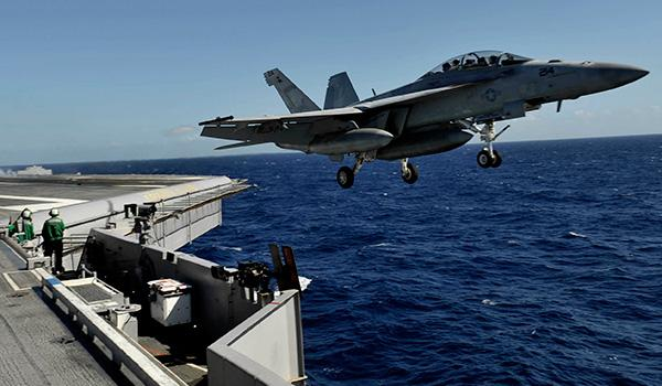"""Strike fighter squadrons VFA-31 (the """"Tomcatters"""") and VFA-213 (the """"Black Lions"""") fly the larger F/A-18E/F Super Hornet. Pictured, an F/A-18F Super Hornet with VFA-213 leaps into the air. (Photo: Petty Officer Second Class Gregory N. Juday)"""