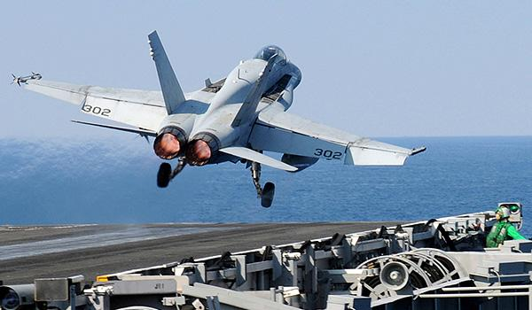 """Strike fighter squadrons VFA-15 (the """"Valions"""") and VFA-87 (the """"Golden Warriors"""") fly the F/A-18C/A Hornet. Pictured, an F/A-18C Hornet with VFA-15 launches from the flight deck. (Photo: Seaman Kevin J. Steinberg)"""