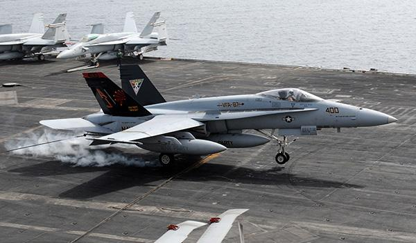 Captain Daniel Dwyer, deputy commander of Carrier Air Wing 8, makes his 1,000th carrier landing as he lands aboard George H.W. Bush in an F/A-18A+ Hornet with VFA-87 in 2011. (Photo: Petty Officer Third Class Billy Ho)