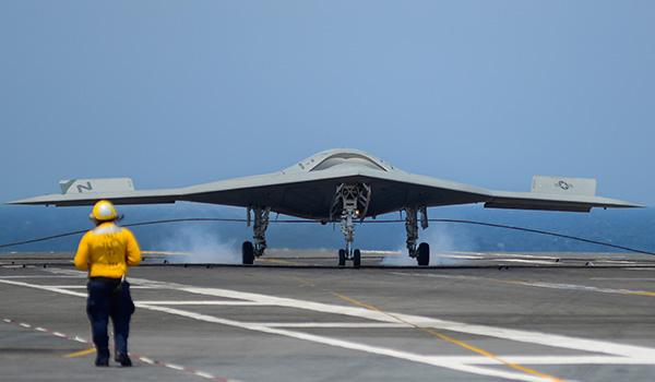 An X-47B Unmanned Combat Air System (UCAS) demonstrator completed an autonomous arrested landing on the flight deck of George H.W. Bush in July, 2013, marking a major milestone in the development of the new jet-powered Navy drone. (Photo: Alan Radecki for Northrop Grumman)