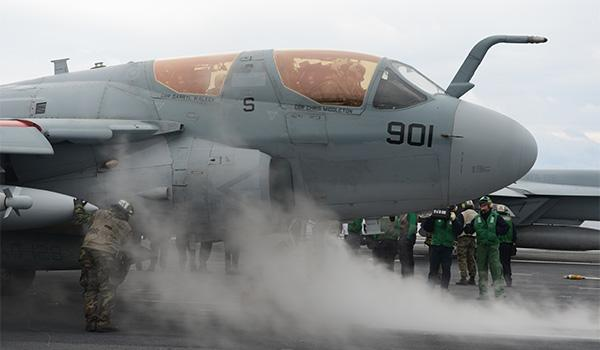 George H.W. Bush also carries four EA-6B Prowler electronic warfare planes and E-2C Hawkeye early-warning and combat-control aircraft, along with other support and transport squadrons. Pictured, sailors prep an EA-6B Prowler aircraft with Electronic Attack Squadron VAQ-129 for launch. (Photo: Mass Communication Specialist Second Class Timothy Walter)