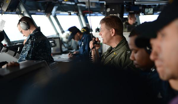 FLIGHT OPERATIONS: Officers and crew on the bridge of USS George H.W. Bush. (Photo: Mass Communication Specialist Second Class Timothy Walter)