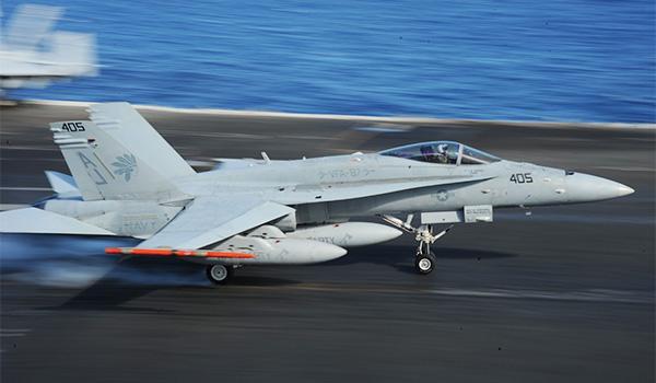 "An F/18-A Hornet with VFA-87 (the ""Golden Warriors"") lands on the flight deck of George H.W. Bush. (Photo: Mass Communication Specialist Seaman Robert Burck)"