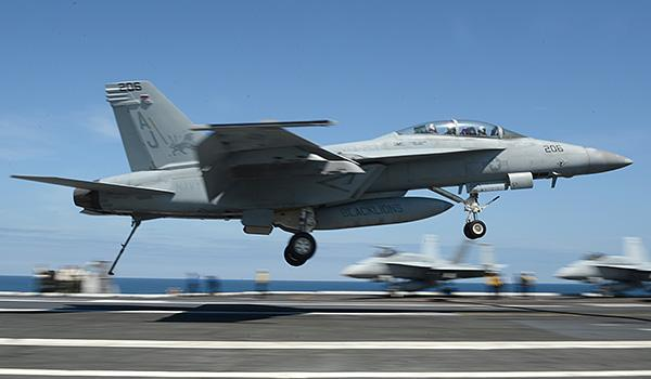 """An F/A-18F Super Hornet with VFA-213 (the """"Black Lions"""") approaches for a landing on George H.W. Bush. (Photo: Mass Communication Specialist Second Class Timothy Walter)"""