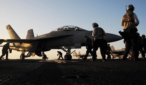 An F/A-18 Super Hornet with VFA-213 stands ready on the flight deck of George H.W. Bush. (Photo: Mass Communication Specialist Second Class Joshua K. Horton)