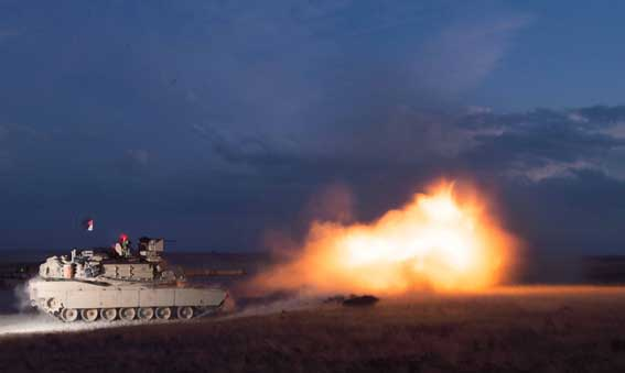 Tank Commander Sgt. Waldon Williams of D Company, 3rd Battalion, 116th Heavy Brigade Combat Team, fires the main gun of his Abrams M1A2 System Enhanced Package (SEP) Tank, Aug. 22, during the unit's three-week annual training at the Orchard Training Center, Idaho.  More than 500 Soldiers with the Oregon Army National Guard took part in the training designed to test their combat readiness. (Photo by U.S. Army Maj. Wayne (Chris) Clyne, 115th Mobile Public Affairs Detachment, Oregon Army National Guard)