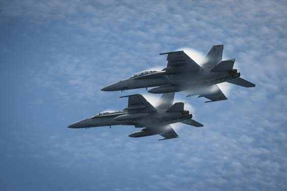 An F/A-18C Hornet from the Stingers of Strike Fighter Squadron (VFA) 113 and an F/A-18E Super Hornet from the Fighting Redcocks of Strike Fighter Squadron (VFA) 22 fly in formation over the flight deck of the aircraft carrier USS Carl Vinson (CVN 70). Carl Vinson is underway off the coast of Southern California conducting Carrier Qualifications as part of the ship's western Pacific deployment 2014. (U.S. Navy photo by Mass Communication Specialist 2nd Class George M. Bell/Released)