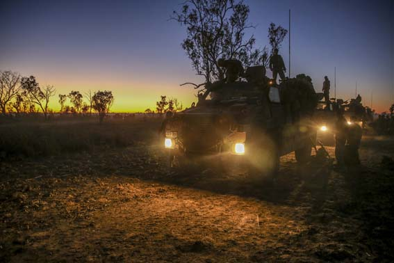 Marines with Bravo Company, 1st Battalion, 5th Marine Regiment, Marine Rotational Force-Darwin, are transported by Australian Protected Mobility Vehicles to ranges during a live-fire exercise at Bradshaw Field Training Area during Exercise Koolendong, August 2014. The focus of Exercise Koolendong 2014 is to establish a 4th Marines and Australian Defence Force combined headquarters element, directing ground, aviation and logistics capabilities in austere conditions, employing all maneuver elements in execution of the exercise.