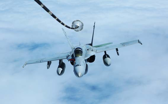 """An F/A-18C Hornet with Marine Fighter Attack Squadron 122 lines up behind an Air Force KC-10 Extender to conduct aerial refueling over the Pacific Ocean, August 23, 2014. The Hornet flew from Hawaii to Eielson Air Force Base in Alaska. While in Alaska, VMFA-122, nicknamed the """"Werewolves,"""" is scheduled to conduct unit level training and fly with squadrons from the United States Air Force to enhance interoperability between services."""