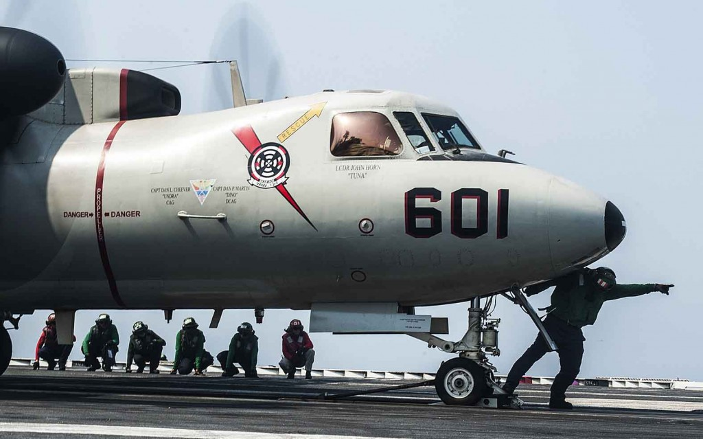 140901-N-MW819-066  ARABIAN GULF (Sept. 1, 2014)  Sailors prepare to launch an E-2C Hawkeye assigned to the Bear Aces of Carrier Airborne Early Warning Squadron (VAW) 124 from the flight deck of the aircraft carrier USS George H.W. Bush (CVN 77). George H.W. Bush is supporting maritime security operations and theater security cooperation efforts in the U.S. 5th Fleet area of responsibility.  (U.S. Navy photo by Mass Communication Specialist 3rd Class Brian Stephens/Released)