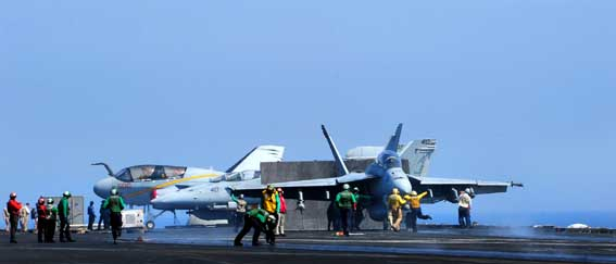 U.S. Sailors direct aircraft on the flight deck of the aircraft carrier USS George H.W. Bush (CVN 77) in the Persian Gulf Oct. 2, 2014, as the ship supports operations in Iraq and Syria. President Barack Obama authorized humanitarian aid deliveries to Iraq as well as targeted airstrikes to protect U.S. personnel from extremists known as the Islamic State in Iraq and the Levant. U.S. Central Command directed the operations. (U.S. Navy photo by Mass Communication Specialist 3rd Class Joshua Card/Released)