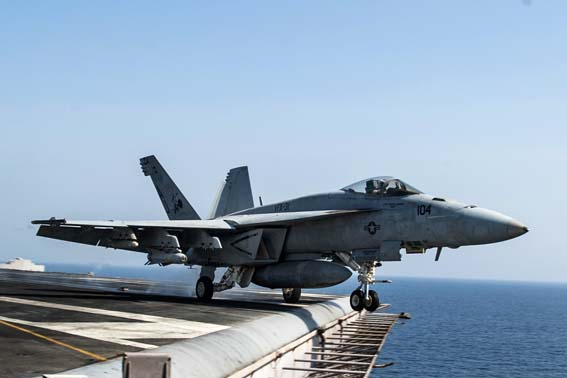 "141002-N-MW819-053 ARABIAN GULF (Oct. 2, 2014) An F/A-18E Super Hornet, attached to the ""Tomcatters"" of Strike Fighter Squadron (VFA) 31, takes off from the flight deck of the aircraft carrier USS George H.W. Bush (CVN 77). George H.W. Bush is supporting maritime security operations, strike operations in Iraq and Syria as directed, and theater security cooperation efforts in the U.S. 5th Fleet area of responsibility.  (U.S. Navy photo by Mass Communication Specialist 3rd Class Brian Stephens/Released)"