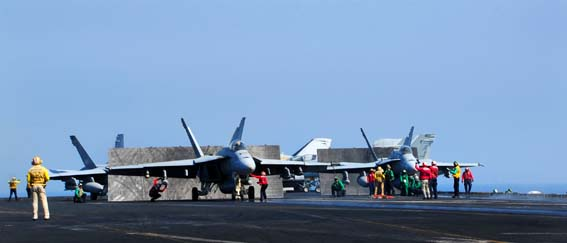 U.S. Sailors inspect aircraft before launching them from the flight deck of the aircraft carrier USS George H.W. Bush (CVN 77) in the Persian Gulf Oct. 2, 2014, as the ship supports operations in Iraq and Syria. President Barack Obama authorized humanitarian aid deliveries to Iraq as well as targeted airstrikes to protect U.S. personnel from extremists known as the Islamic State in Iraq and the Levant. U.S. Central Command directed the operations. (U.S. Navy photo by Mass Communication Specialist 3rd Class Joshua Card/Released)
