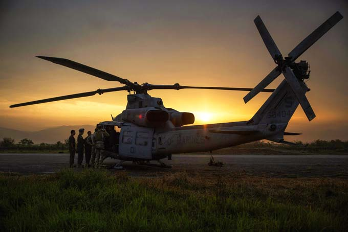 U.S. Marines prepare a UH-1Y Huey helicopter to begin a search and rescue mission out of the Tribhuvan International Airport, Kathmandu, Nepal May 13. A UH-1Y Huey assigned to Marine Light Attack Helicopter Squadron 469, carrying six Marines and two Nepalese soldiers, went missing while conducting humanitarian assistance after a 7.3 magnitude earthquake yesterday. HMLA-469, currently part of Joint Task Force 505 participating in Operation Sahayogi Haat, responded in support the government of Nepal after the 7.8 magnitude earthquake struck their country, April 25. (U.S. Marine Corps Photo by Cpl. Thor J. Larson/Released)